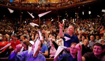 Audience members throw paper airplanes at the stage during the 26th First Annual Ig Nobel Prize ceremony at Harvard University in Cambridge, Massachusetts, U.S. September 22, 2016. REUTERS/Brian Snyder